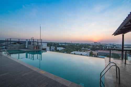 The swimming pool at or near Sai Vishram Business Hotel