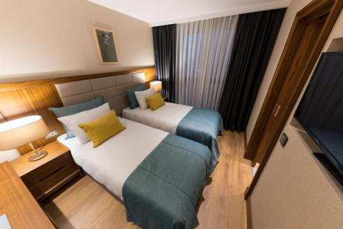 A bed or beds in a room at Endless Art Hotel-Special Category