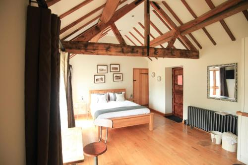A bed or beds in a room at Manor Farm-MK Executive Accommodation