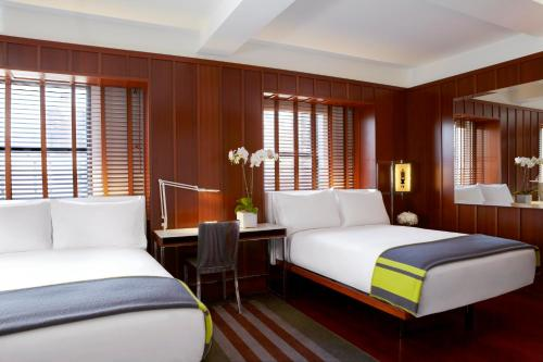 A bed or beds in a room at Hudson New York