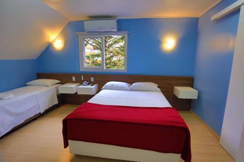 Cama ou camas em um quarto em Hotel Colina Premium São Francisco