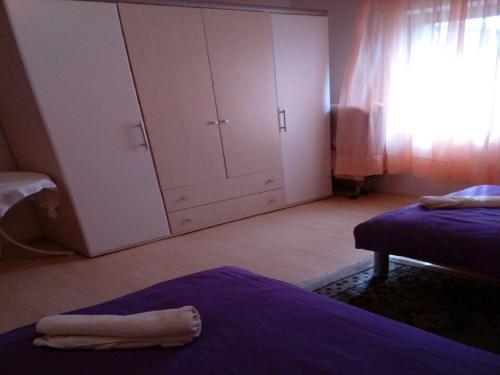 Postel nebo postele na pokoji v ubytování House Nada