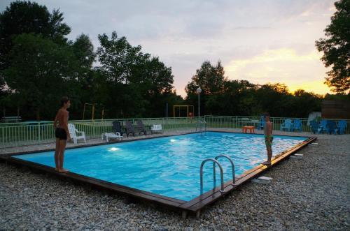 The swimming pool at or near Camping les Plages de l'Ain