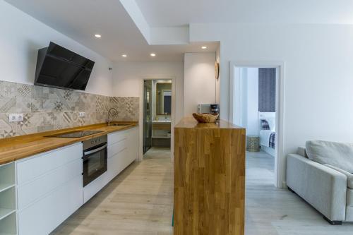 Una cocina o zona de cocina en Deluxe Apartment Las Canteras with Wifi