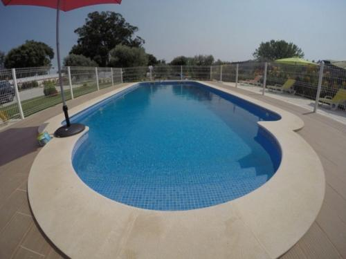 The swimming pool at or near Farmer Fraguas