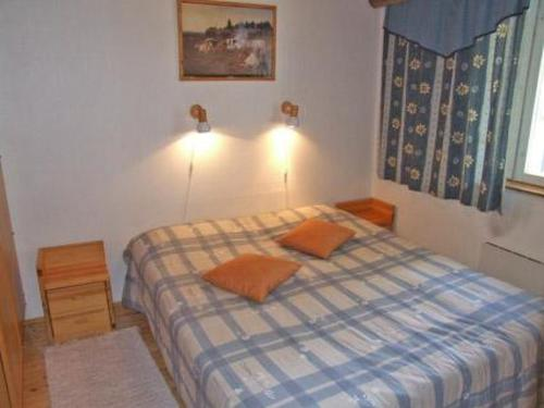 A bed or beds in a room at Holiday Home Revonaapa c18