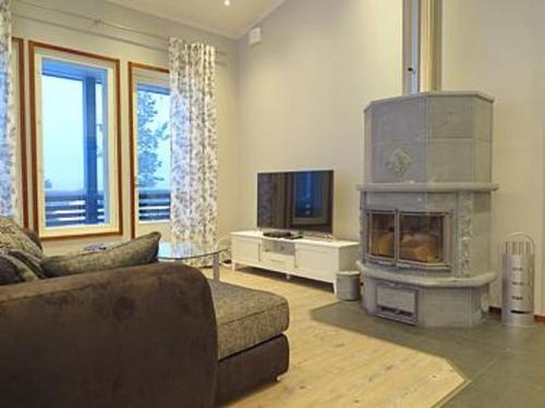 A seating area at Holiday Home Karhu a