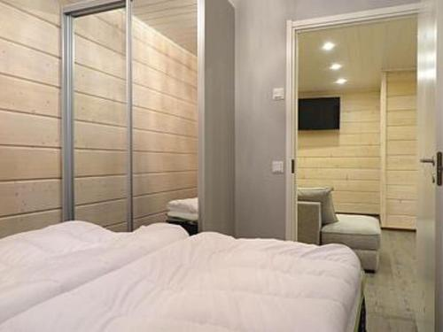 A bed or beds in a room at Holiday Home Karhu a