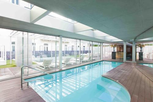 The swimming pool at or near BessaHotel Liberdade