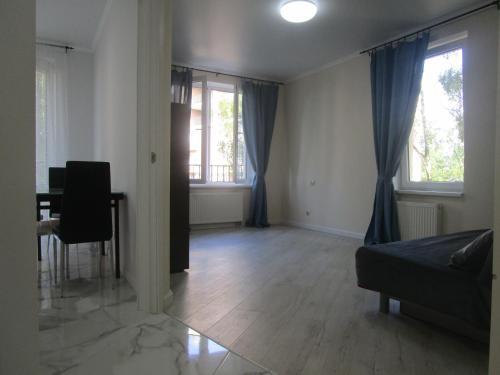 Гостиная зона в Апартаменты на Калининградском проспекте 79б