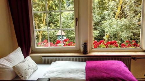 Ein Bett oder Betten in einem Zimmer der Unterkunft Hotel in der Strassen