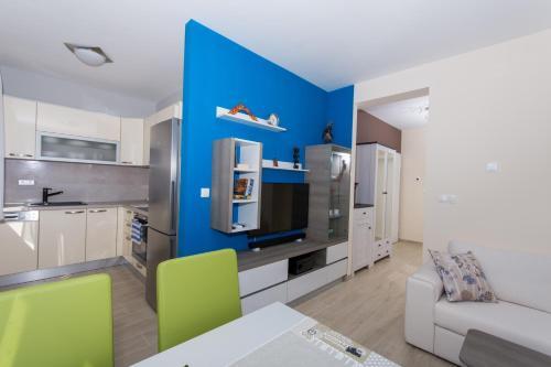 Kuchyň nebo kuchyňský kout v ubytování Apartman Api