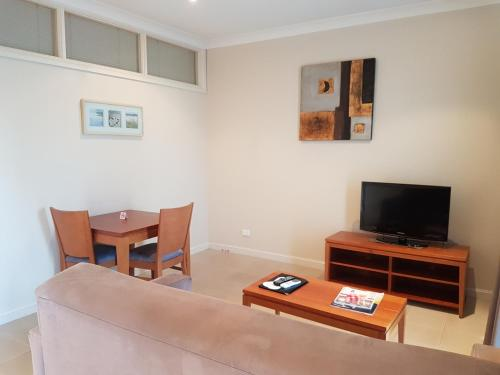 A television and/or entertainment centre at Vine Inn Barossa