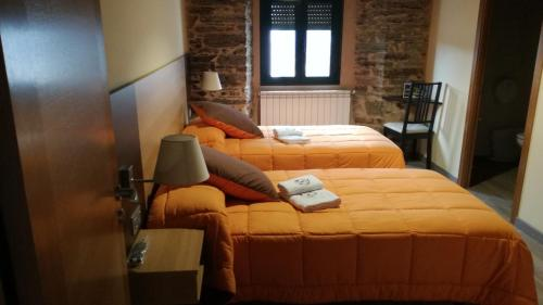 A bed or beds in a room at Albergue Pension Porta Santa