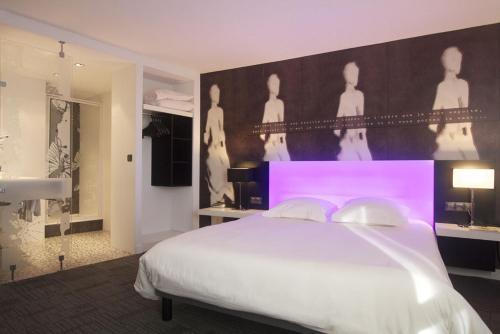 Un ou plusieurs lits dans un hébergement de l'établissement Les Asteries Ploemeur-Lorient