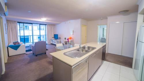 A kitchen or kitchenette at Inner City Brisbane Resort Living