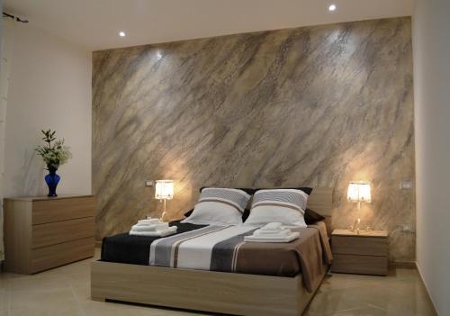 Ein Bett oder Betten in einem Zimmer der Unterkunft Casa Low Cost