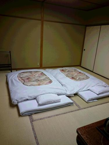 Letto o letti in una camera di Ryokan Mitsuwa