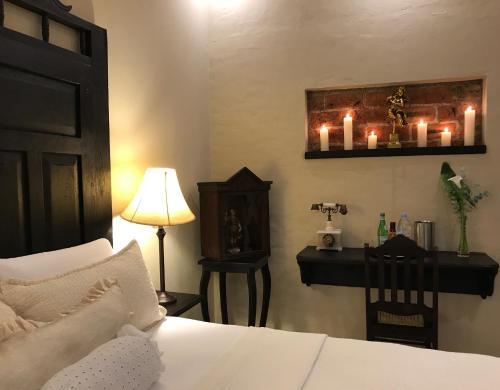 Cama o camas de una habitación en Casa Degraciela Hotel Boutique