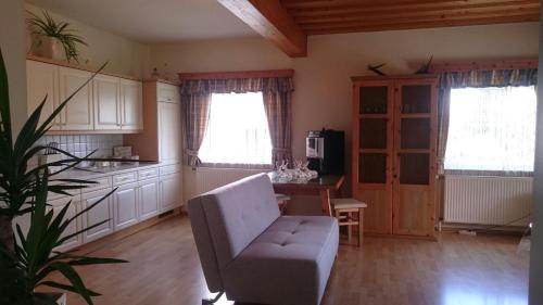 Ein Sitzbereich in der Unterkunft Gartler's Ferienhaus