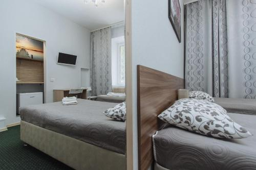 Кровать или кровати в номере Мини отель Фортуна-Сити на Анатолия Живова