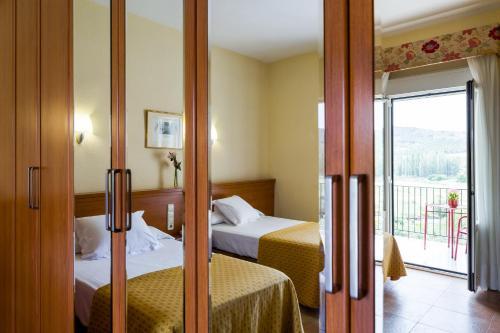 A bed or beds in a room at Balneario de Fitero - Hotel Bécquer