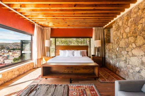 A bed or beds in a room at Casa del Rector Hotel Boutique y Arte- Adult Only