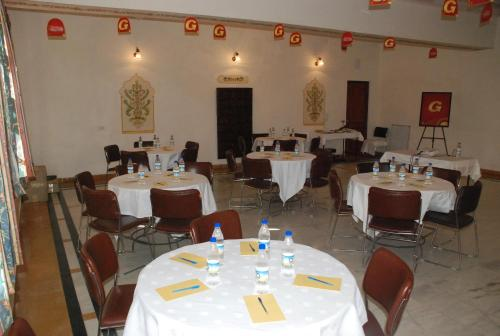 A restaurant or other place to eat at WelcomHeritage Mandir Palace