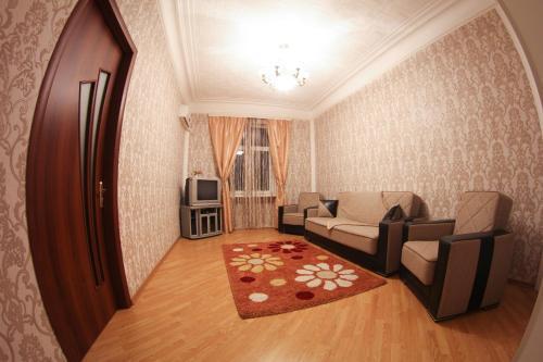 Uma área de estar em Apartment Bilal