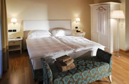 Кровать или кровати в номере Dependance Lipa