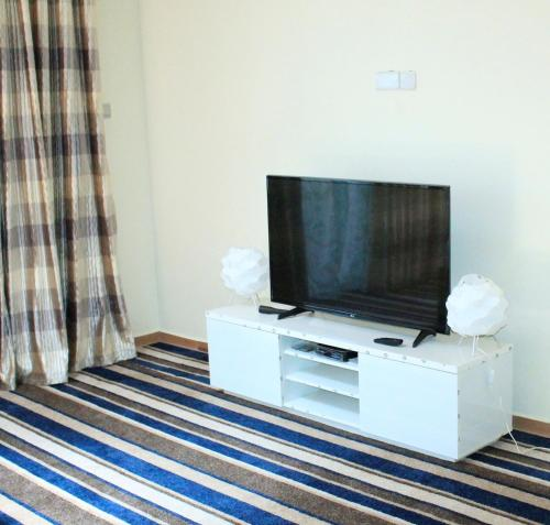 A television and/or entertainment center at L L Apartments Ntinda