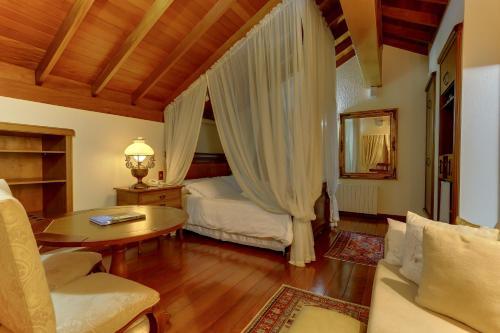 Cama ou camas em um quarto em Hotel Pousada Florença