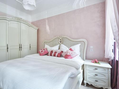Postel nebo postele na pokoji v ubytování Apart House Plesia
