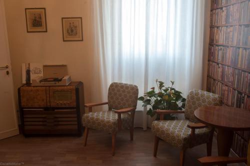 Area soggiorno di Dimora 16 Rooms & Garden