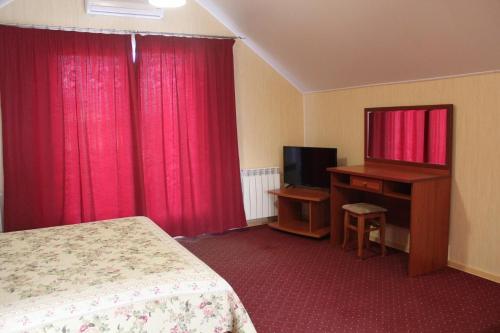 Телевизор и/или развлекательный центр в Apartments on Ulitsa Tenistaya