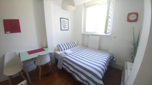 Un ou plusieurs lits dans un hébergement de l'établissement Cosy Studio Amiens