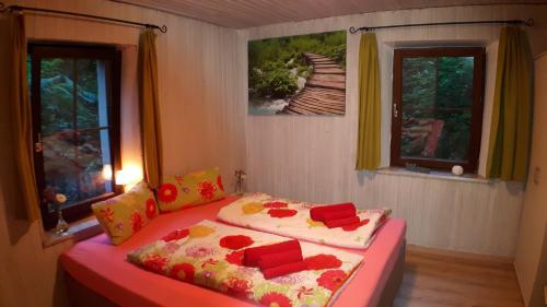 Ein Bett oder Betten in einem Zimmer der Unterkunft Das Haus am Hang