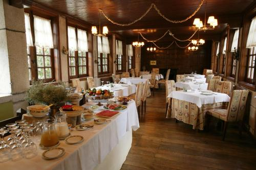 A restaurant or other place to eat at Pazo La Buzaca