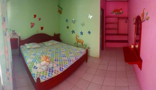 A bed or beds in a room at Casa Paraiso Ahora Si Italian & Vegetarian Restaurant Samara Beach