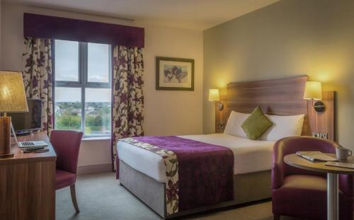 A bed or beds in a room at Maldron Hotel & Leisure Centre, Oranmore Galway