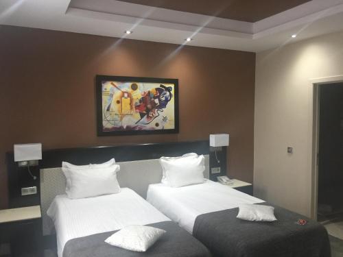 Een bed of bedden in een kamer bij Cour St Georges