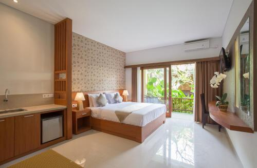 A bed or beds in a room at Grand Sehati & Spa, Ubud