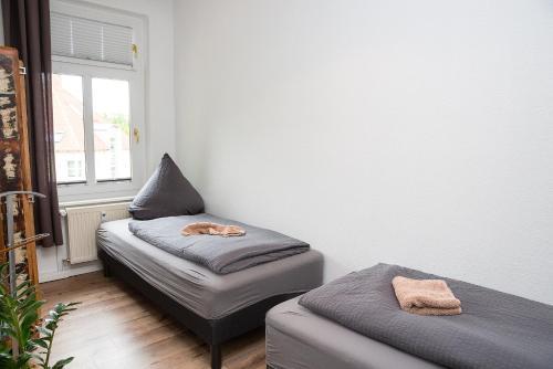 Ein Bett oder Betten in einem Zimmer der Unterkunft Uferpromenade