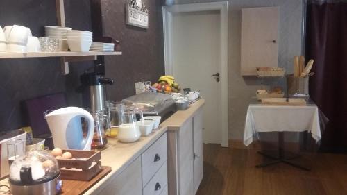 A kitchen or kitchenette at Auberge De Lavacherie