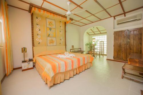 A bed or beds in a room at Sigiriya Village