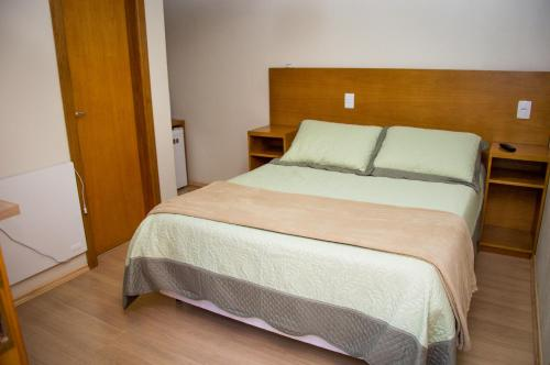 A bed or beds in a room at Morada Bem Me Quer