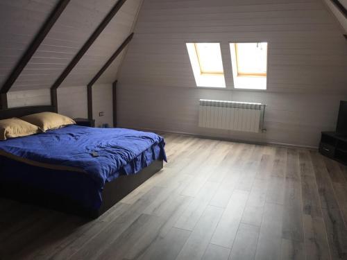 Кровать или кровати в номере Guesthouse Alina