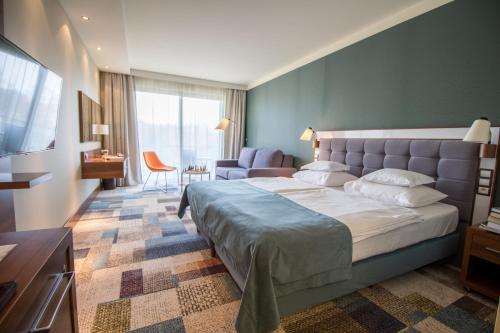 Łóżko lub łóżka w pokoju w obiekcie Hotel Aquarius SPA