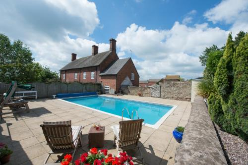 The swimming pool at or near Cart Shed Cottage