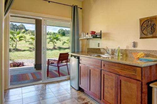 A kitchen or kitchenette at Mahana House Country Inn